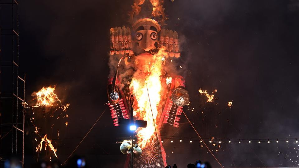 Effigy of Ravan burns during Vijay Dashmi (Dashehra) celebrations, at Shri Dharmik Ramlila Committee, Red Fort Ground, in New Delhi. Dusshera is celebrated at the end of Navaratri every year. It is observed on the tenth day in the Hindu calendar month of Ashvin or Kartik. (Mohd Zakir/HT Photo)