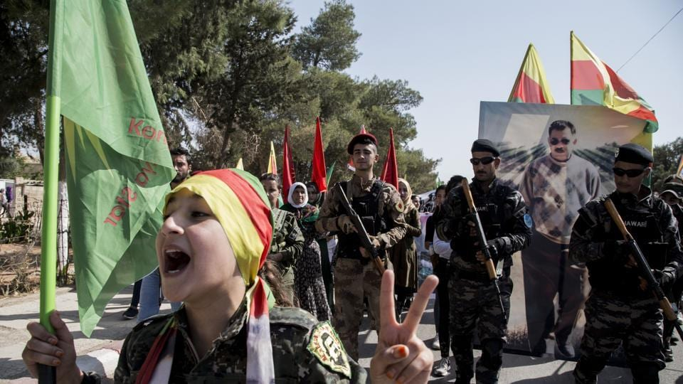 Fighters of the Syrian Democratic Forces SDF march during a demonstration against possible Turkish military operation in their areas in Al-Qahtaniya Syria