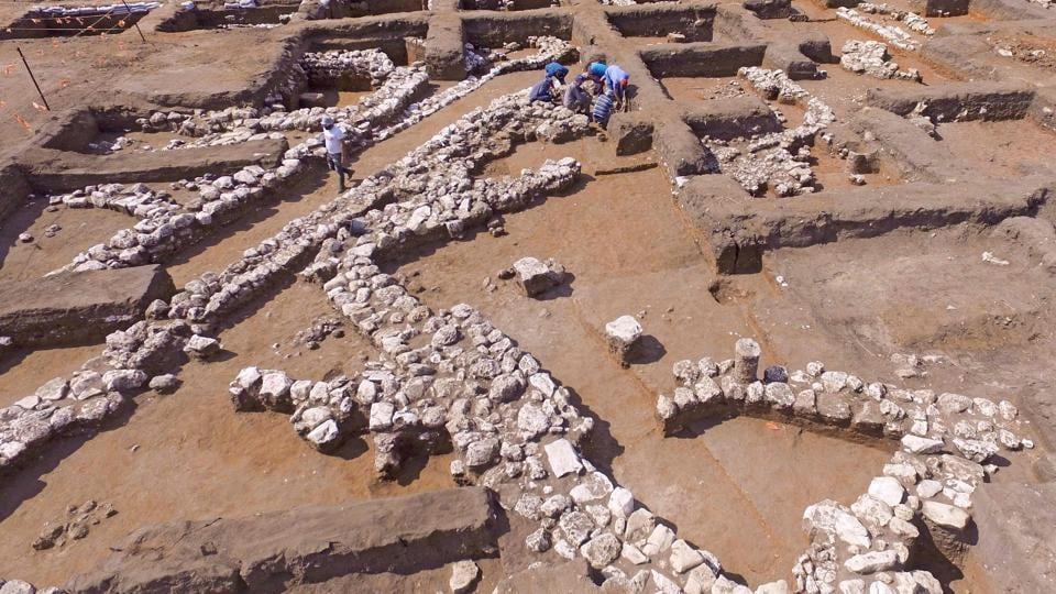 Israeli archaeologists work at the ancient site of En Esur (Ein Asawir) where a 5000-year-old city was uncovered, near the Israeli town of Harish. Archaeologists from the Israel Antiquities Authority said the excavations carried out over the course of two and a half years revealed a city among the biggest from its era in the region, including fortifications, a ritual temple and a cemetery.  (Jack Guez / AFP)