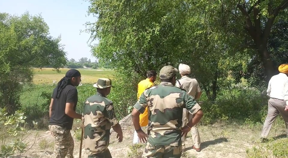 A search team hunts for drones that have been seen for three consecutive days over the  villages of Hussainiwala sector in Punjab's Ferozepur district along the border with Pakistan.