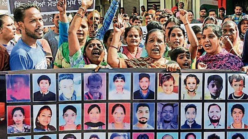 The families of  those who were run over by a train during Dussehra celebrations last year stage a protest in Amritsar on Tuesday.