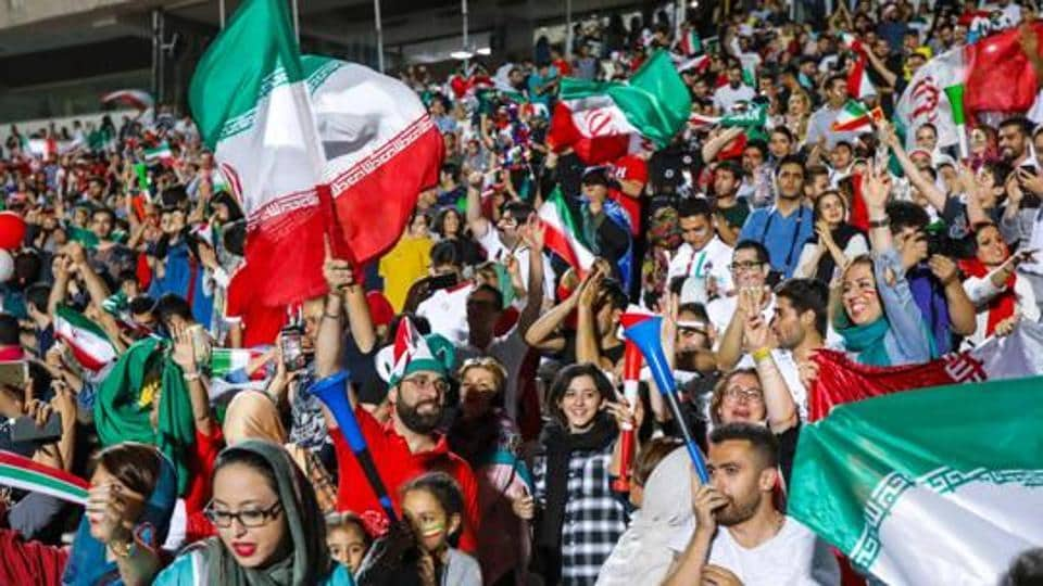File image- Iranian football supporters wave their national flags.