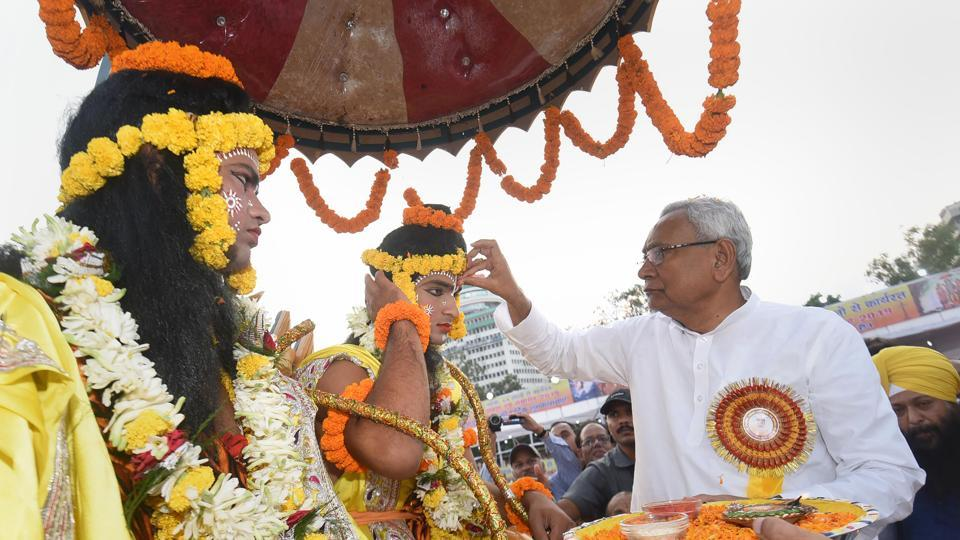 Patna: Bihar Chief Minister Nitish Kumar applies 'tilak' on the forehead of an artist dressed as Lord Ram during Dussehra celebrations at Gandhi Maidan in Patna on Tuesday.