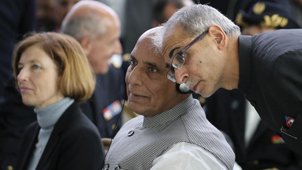 Indian Defense Minister Minister Rajnath Singh, listens to an aide as French Defense Minister Florence Parly, left, listens during a ceremony at the Dassault Aviation plant in Merignac, near Bordeaux.