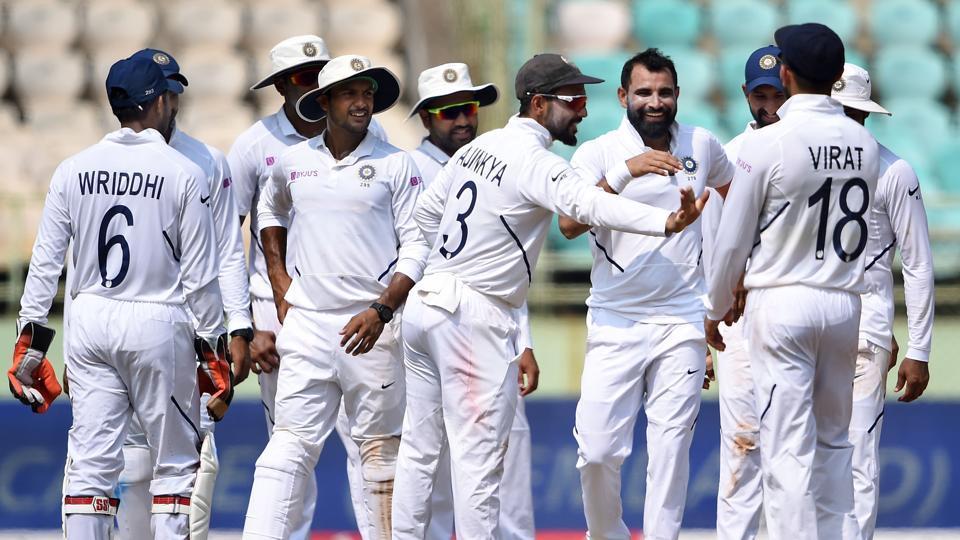 India's Mohammed Shami celebrates with teammates.