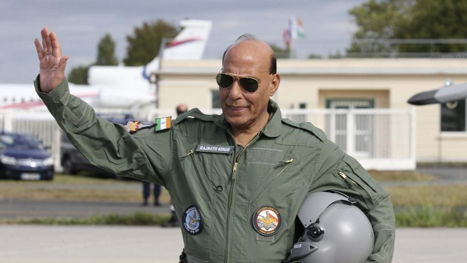 Defence Minister Rajnath Singh gestures before a test flight in a Rafale jet fighter at the Dassault Aviation plant in Merignac, near Bordeaux, southwestern France, Tuesday, Oct. 8, 2019.