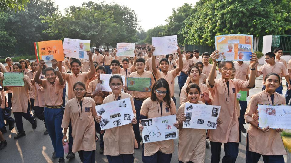 Students and teachers take park in activities to celebrate Mahatma Gandhi's birth anniversary at Sanskriti School in Chanakya Puri, New Delhi on October 1
