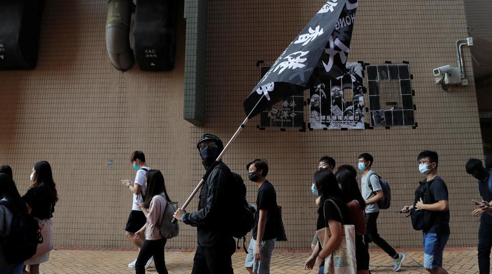 Students at Hong Kong Baptist University take part in a rally after police entered the campus on Sunday while chasing protesters, in Hong Kong, China October 8, 2019.