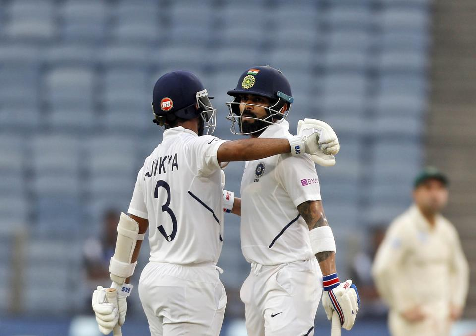 India's Virat Kohli, right, celebrates his fifty with Ajinkya Rahane during second cricket test match between India and South Africa in Pune. (AP)