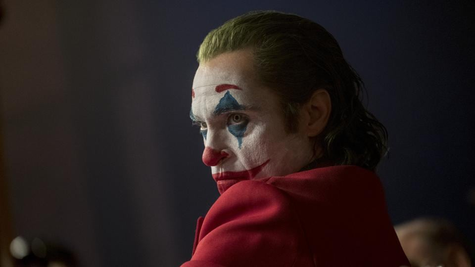 This image released by Warner Bros. Pictures shows Joaquin Phoenix in a scene from Joker.