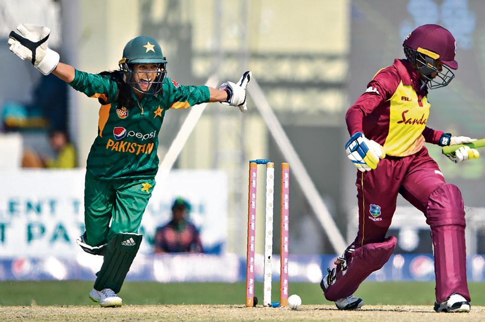Pakistani wicketkeeper Sidra Nawaz (L) celebrates after West Indies cricketer Shermaine Campbelle is clean bowled during the third and last T20 match between the Pakistan and West Indies' women's cricket teams at the Southend Club Cricket Stadium in Karachi on February 3, 2019.