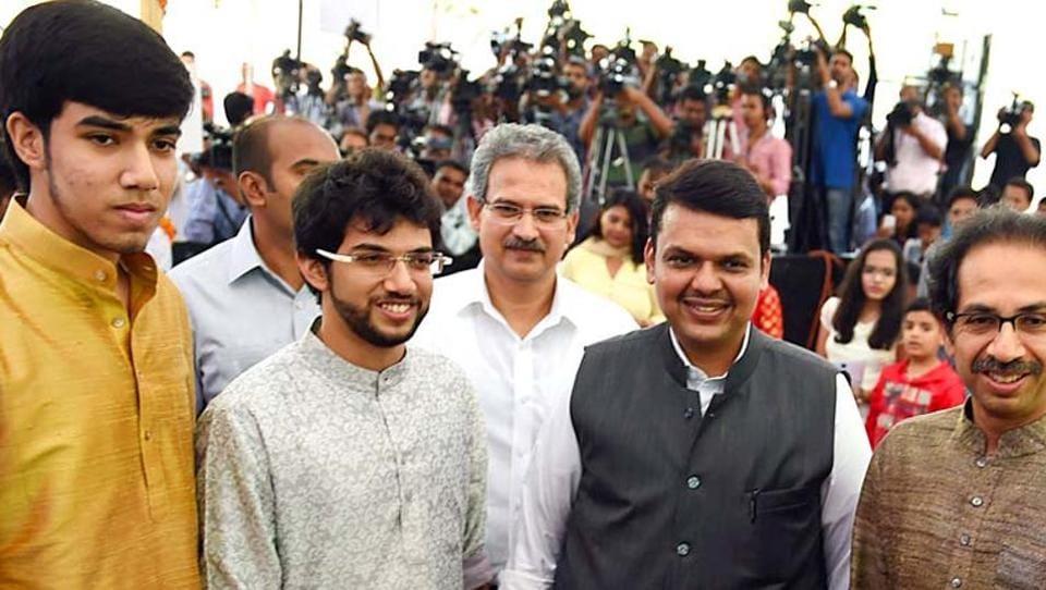 Maharashtra CM Devendra Fadnavis along with Tejas and Aditya Thackeray.