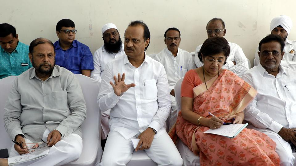 Ajit Pawar (centre) while addressing party workers at Nisarg hall, on Wednesday.