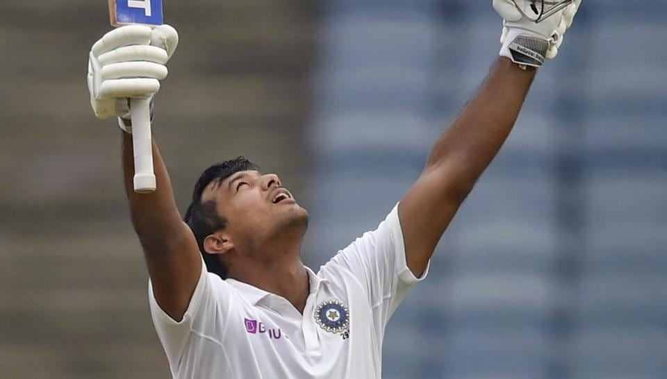 Indian cricketer Mayank Agarwal raises his bat after scoring a century during the second India-South Africa cricket test match at Maharashtra Cricket Association Stadium, in Pune, Thursday, Oct. 10, 2019.