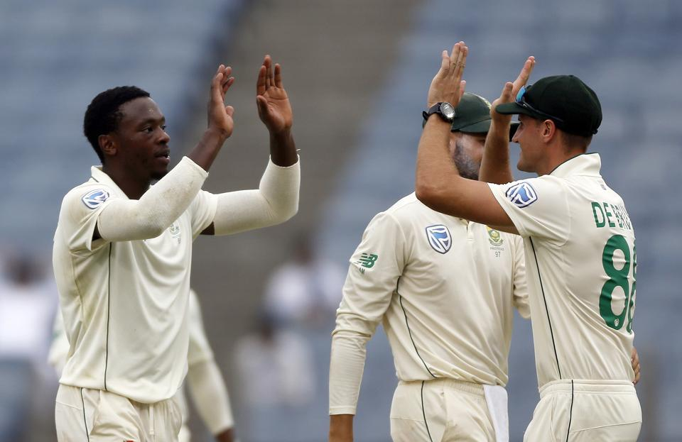 South Africa's Kagiso Rabada, left, celebrates with teammates the dismissal of India's Mayank Agarwal during the second cricket test match between India and South Africa in Pune. (AP)