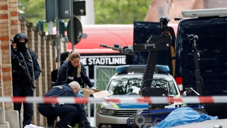 Police officers work at the site of a shooting, in which two people were killed, in Halle, Germany on October 9, 2019.