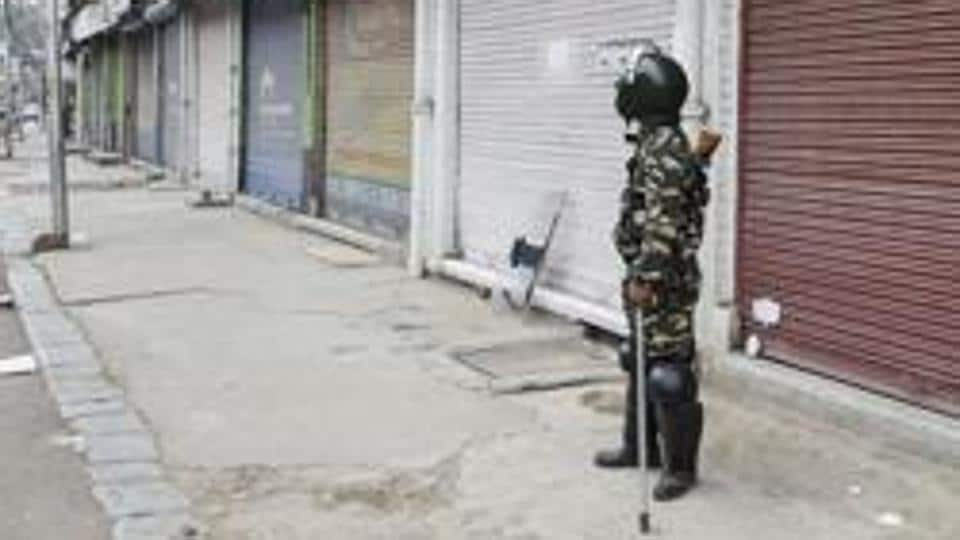 A security person stands guard during shutdown, in Srinagar on October 3, 2019.