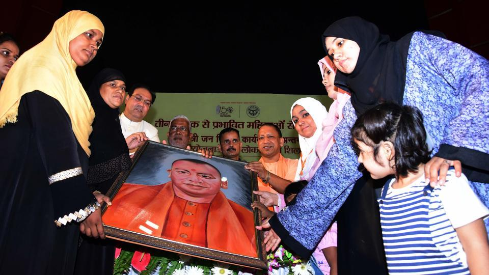 A group of women who were affected by triple talaq presents a portrait to Uttar Pradesh Chief Minister Yogi Adityanath during their felicitation ceremony, at Indira Gandhi Pratishthan, in Lucknow.