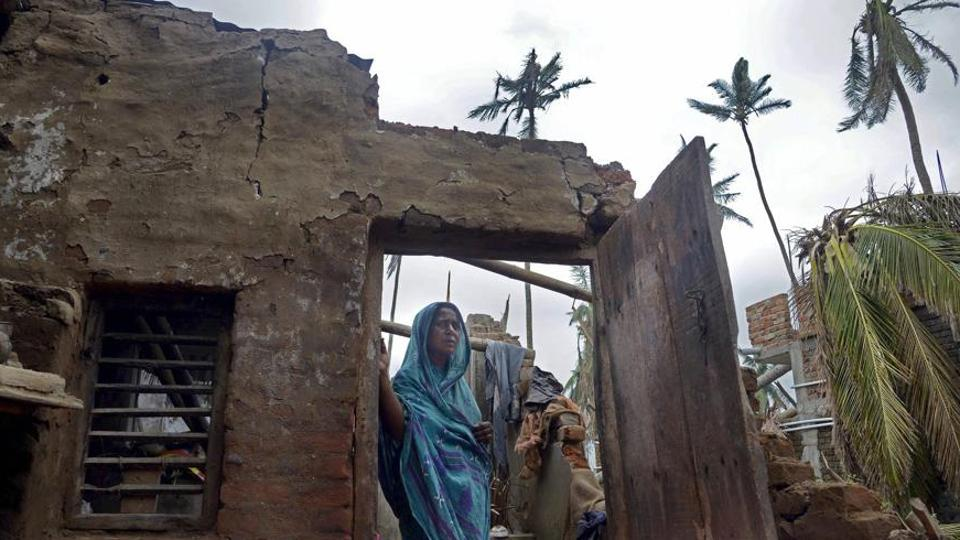 **EDS: WITH BHASHA STORY PRADESHIK6** Puri: A woman stands in the remnants of her home in the aftermath of cyclone 'Fani', at the heritage crafts village Raghurajpur, in Puri district, Friday, May 10, 2019. (PTI Photo)(PTI5_13_2019_000058B)