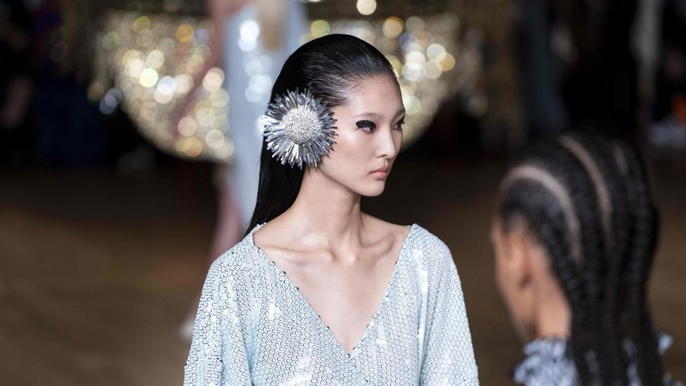 Models present creations by Halpern during a catwalk show for the Spring/Summer 2020 collection on the second day of London Fashion Week, September 14, 2019