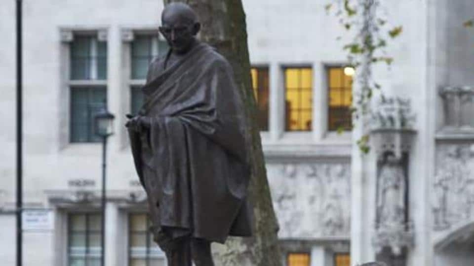 A statue of Mahatma Gandhi, in Parliament Square, London. Britain has decided to mint coin with images of Mahatma Gandhi.