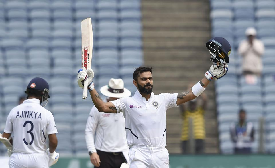 Pune: Indian cricket team Captain Virat Kohli raises his bat after scoring a century on the day 2 of second India-South Africa cricket test match, at Maharashtra Cricket Association Stadium in Pune. (PTI)