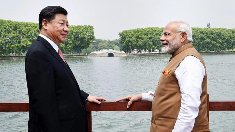 Prime Minister Narendra Modi with Chinese President Xi Jinping along the East Lake, in Wuhan, China.