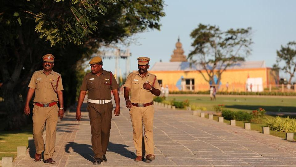 Policemen patrol inside the premises of Shore temple a day before the visit of Chinese President Xi Jinping in Mamallapuram on the outskirts of Chennai.