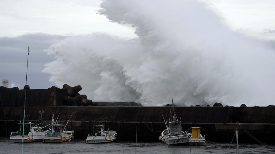 Surging waves hit against the breakwater while Typhoon Hagibis approaches at a port in town of Kiho, Mie.