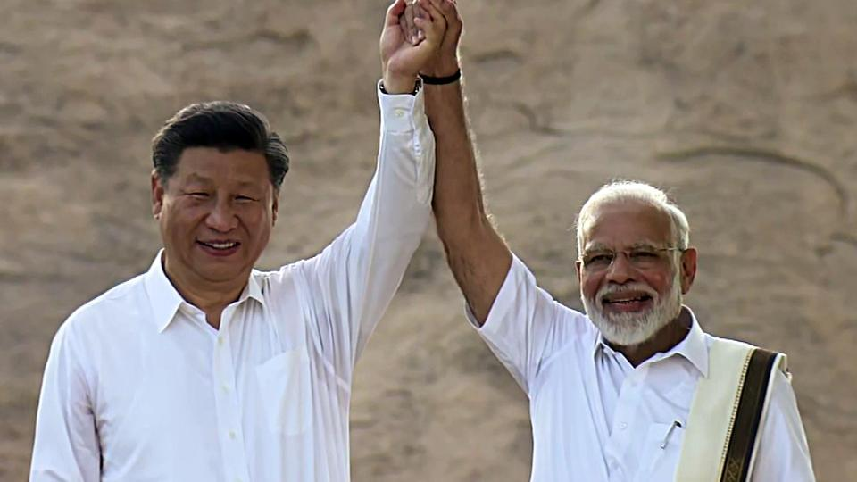 Prime Minister Narendra Modi holds hand with Chinese President Xi Jinping at the famous site of Pallava Era during the 2nd informal summit in Mamallapuram on Friday.