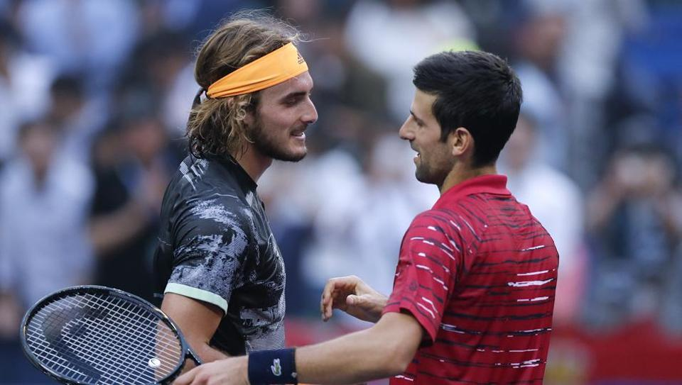 Stefanos Tsitsipas congratulated by Novak Djokovic after winning in their men's singles quarterfinals match at the Shanghai Masters.