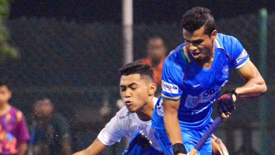 Players of India's junior men's hockey team and Malaysian team in action.