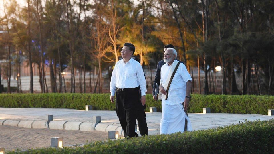 Modi, clad in a white shirt, veshti and angavastram, received Xi after he drove in a motorcade from Chennai to the seaside resort, a distance of some 55km, and the two leaders, accompanied only by translators, made their way around several monuments at the World Heritage Site.