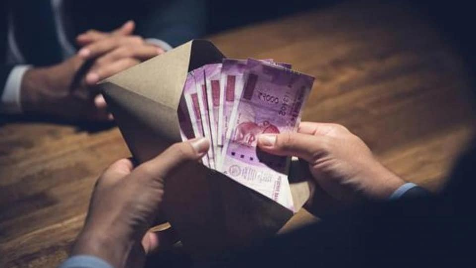 Gurjar was caught red-handed taking a bribe of Rs 50,000 in cash and Rs 75,000 in a cheque.
