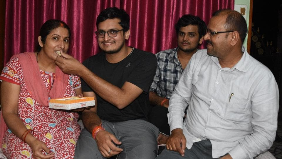 Amit Shukla (second from left) with his parents
