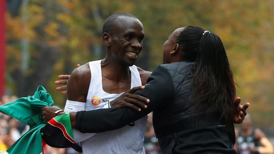 Kenya's Eliud Kipchoge, the marathon world record holder, celebrates after a successful attempt to run a marathon in under two hours in Vienna, Austria, October 12, 2019.