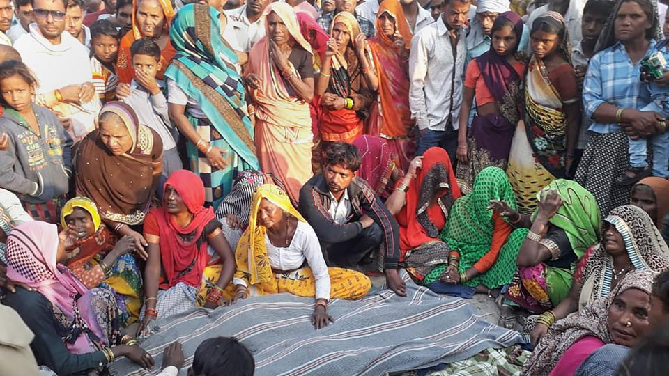Bulandshahr: Family members mourn after their relatives were killed when a bus rammed into a group of pilgrims who were on their way back from the Vaishno Devi shrine and were sleeping on the roadside, in Bulandshahr, Friday, Oct 11, 2019. The seven victims, including three children, were residents of Chandpa in Hathras district.