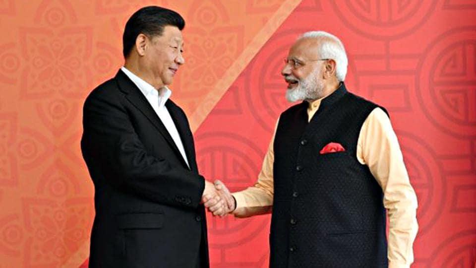 Prime Minister Narendra Modi welcomes Chinese President Xi Jinping at Taj Fisherman's Cove hotel in Kovalam, on Saturday.