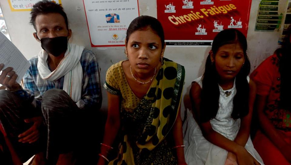 "Tuberculosis (TB) patients wait for their turn to get their daily dose of medicine at a DOTS (directly observed treatment, short-course) centre in New Delhi. India continues to grapple with the disease, becoming home to a quarter of TB cases worldwide. To fight the disease, the government has set an ambitious target of overcoming the TB ""epidemic"" by 2025. Even though the goal seems unachievable, NGOs are providing patients with services to cure them. (Money Sharma / AFP)"