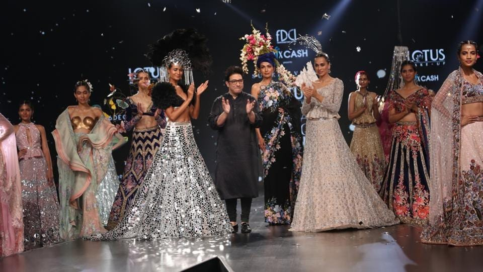 New Delhi: Fashion designer Suneet Varma with models showcasing his creations on the third day of Lotus Make-up India Fashion Week, in New Delhi. (IANS)
