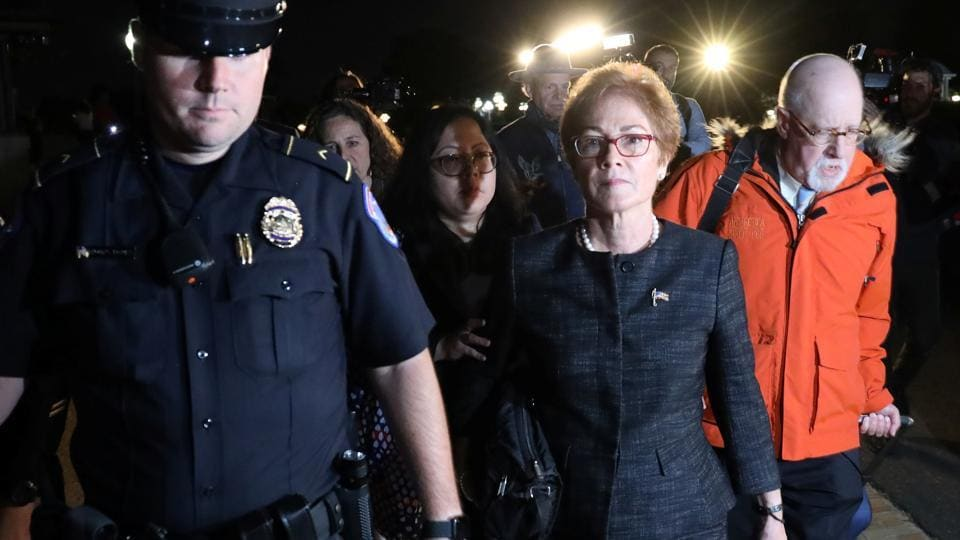 US Capitol Police guide former US ambassador to Ukraine Marie Yovanovitch as she departs after testifying in the US House of Representatives impeachment inquiry into US President Trump on Capitol Hill in Washington on October 11, 2019.