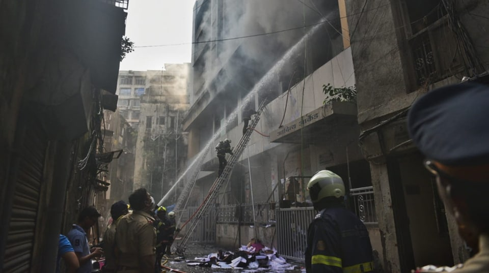 The rescue operation initiated by the fire brigade official is still underway as about 8-10 people are stranded on the fourth floor of the building.