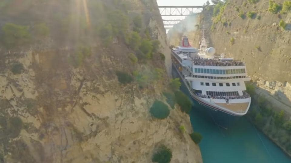 Cruise ship squeezes through tiny canal. Incredible video captured