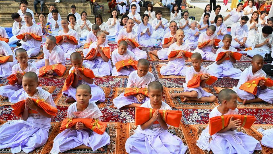 Thai children being ordained as Buddhist novice monks near the sacred Bodhi tree, at Mahabodhi Temple, in Bodh Gaya, Bihar. (PTI)