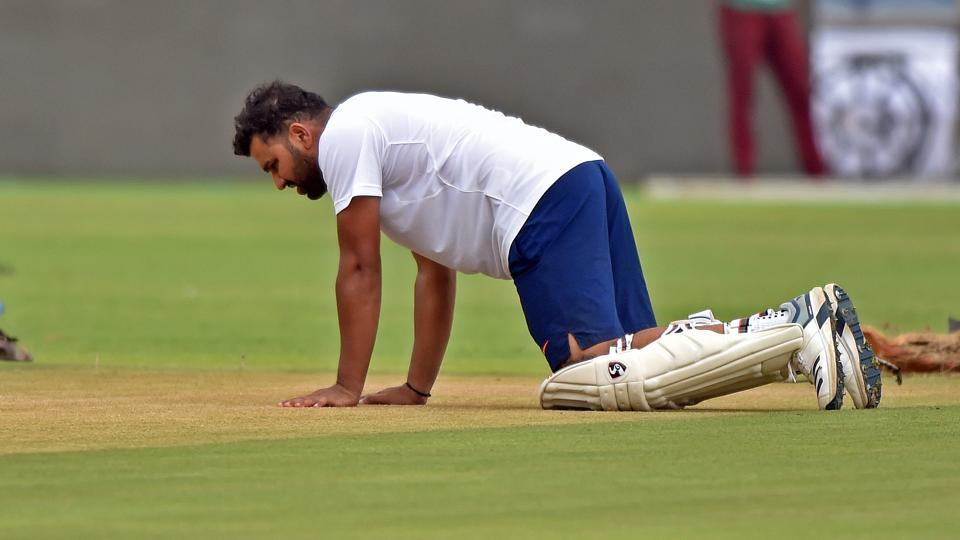 Rohit Sharma inspects the pitch during a practice session at Maharashtra Cricket Association Stadium in Pune.