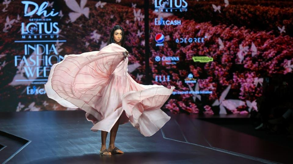 A model showcases a creation by designer Dhi during the FDCI Lotus Make-up India Fashion Week Spring Summer 2020, organised by FDCI at Major Dhyan Chand National Stadium in New Delhi. (Amal KS / HT Photo)