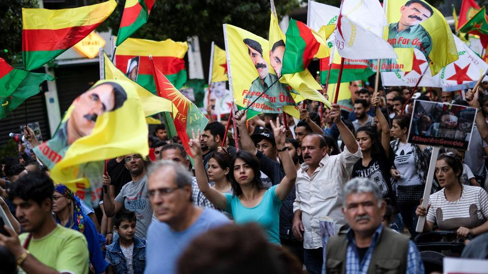 Kurds living in Greece and Greek protesters take part in a demonstration against Turkey's military action in northeastern Syria.