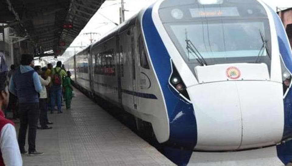 Passengers seen boarding India's first semi-high speed express train Vande Bharat Express.