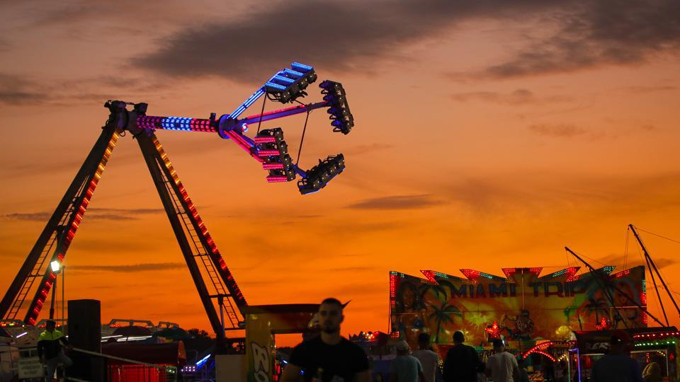 Rides are backdropped by the sunset sky at an autumn fair in Titu, southern Romania. The country's autumn fairs are a loud and colourful reminder that summer has come to an end and, for many families in poorer areas of the country, one of the few affordable public entertainment events of the year. (Vadim Ghirda / AP)