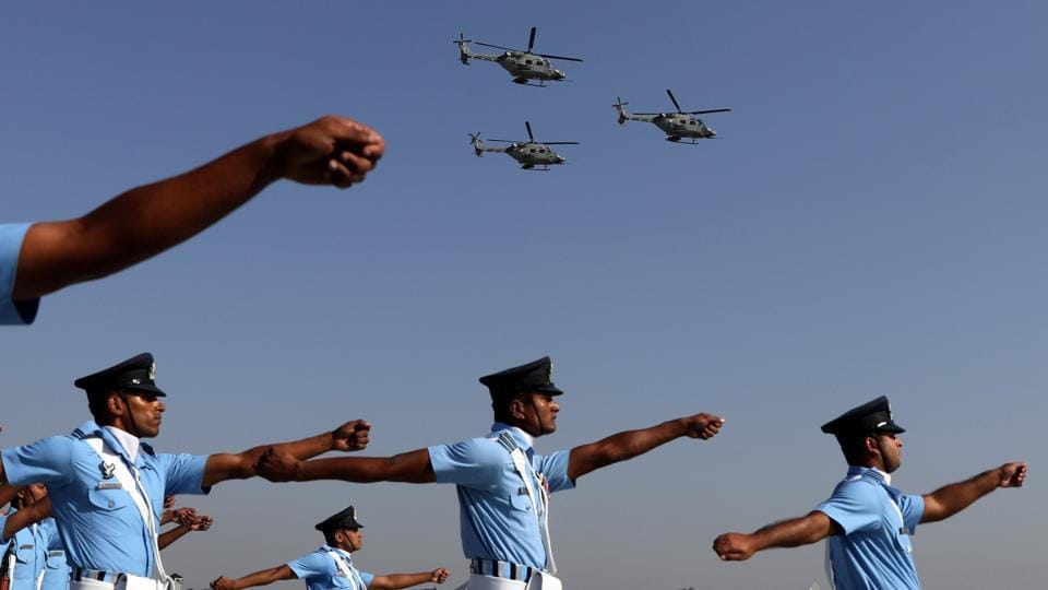 Indian Air Force (IAF) soldiers march as advanced light helicopters fly during the Indian Air Force Day celebrations at the Hindon Air Force Station on the outskirts of New Delhi. (Anushree Fadnavis / REUTERS)